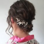 Wavy updo wedding hair with bespoke hair vines