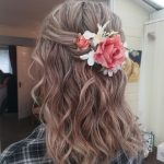 Beach wave wedding hair with bespoke flower hair accessorie